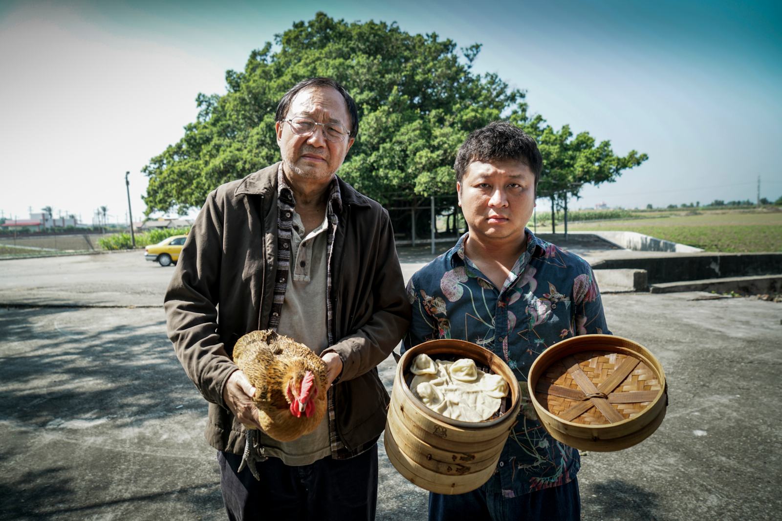 portrait of two men with chicken and dimsum alpha 7RII