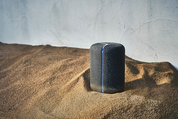 SRS-XB402M wireless speaker on a sandy surface