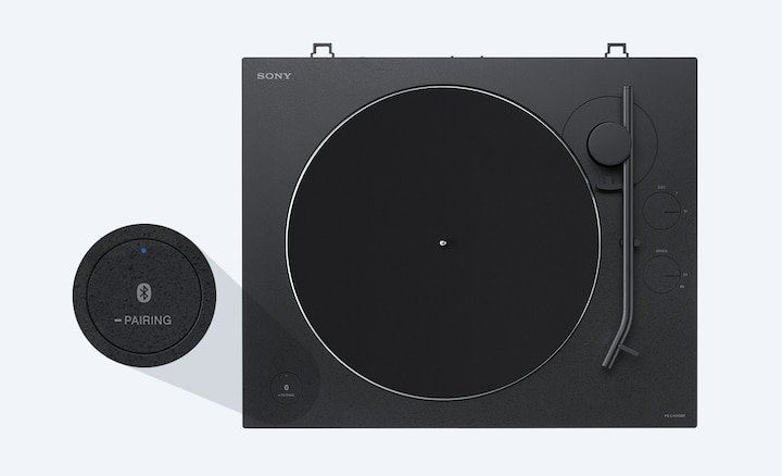 Top view of record player with detail shot of BLUETOOTH pairing button