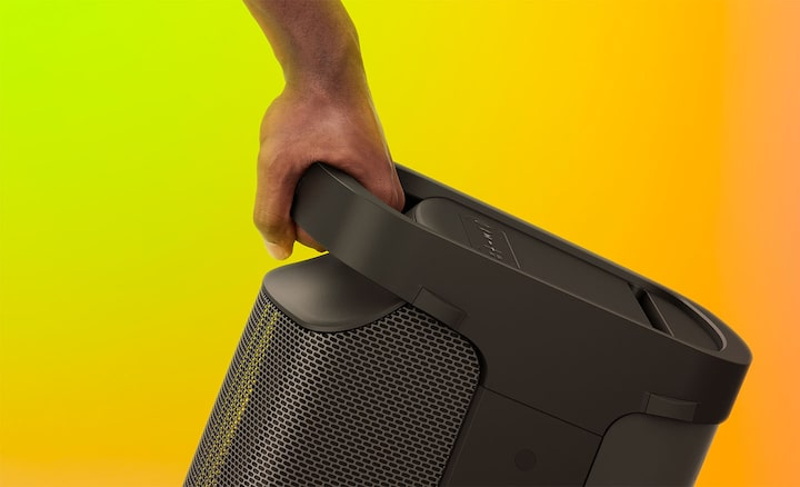 Image of the XP500 X-Series Portable Speaker with a close-up of a hand on the comfortable handle.