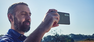 Man filming on Xperia 1 III outside