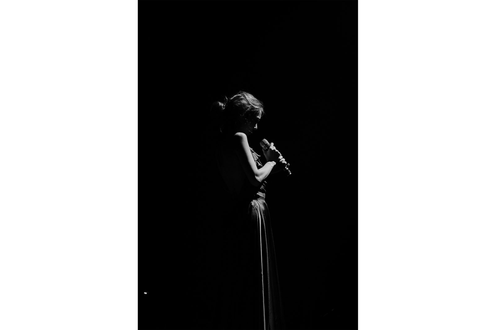 monotonous woman in the shadows holding microphone alpha 7RII