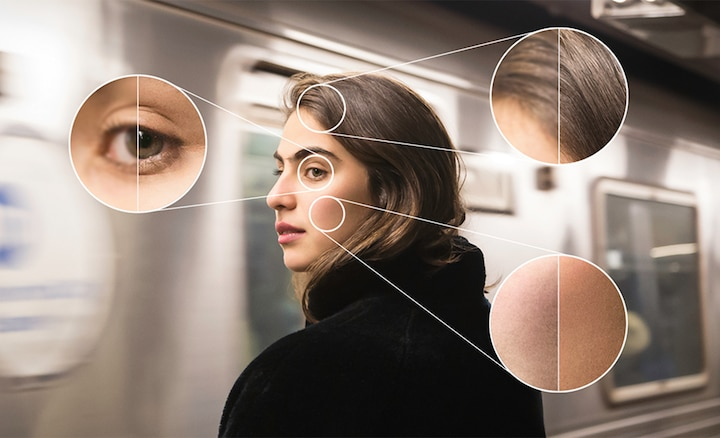 An image of a woman on a train highlighting the focus improvements BRAVIA XR provides