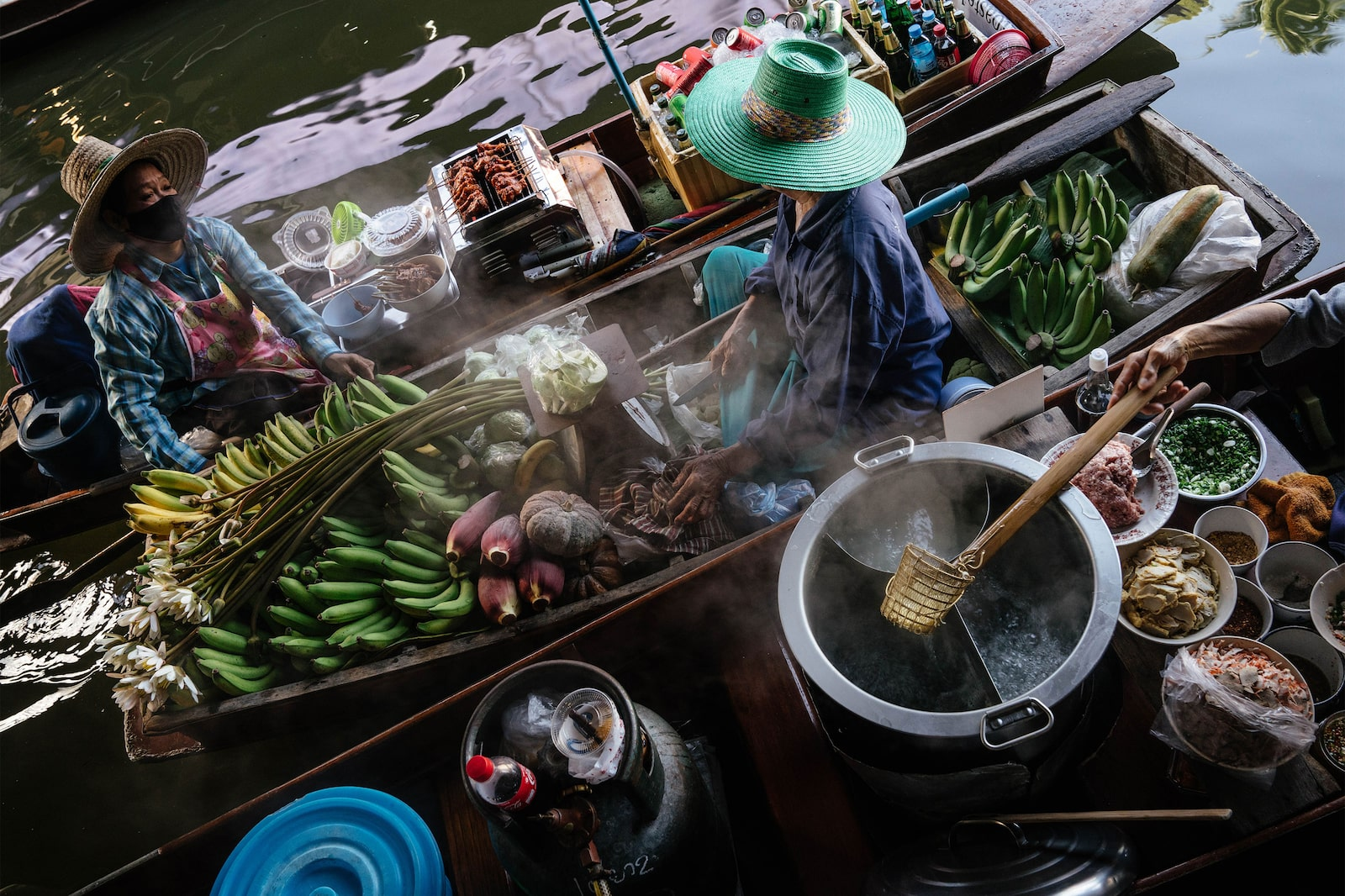 Loaded sampan boats in the floating market